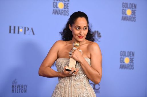 tracee-ellis-ross-poses-with-the-award-f
